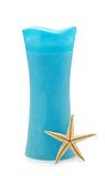 Blue shower gel in bottle with sea star Stock Image