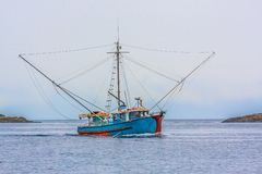 Free Blue Shrimp Boat On Grey Day Royalty Free Stock Images - 128079199