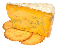 Blue Shropshire Cheese. Traditional English blue Shropshire cheese and biscuits, isolated on a white background Stock Images