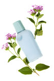 Blue Shumpoo, Fresh of Nature. Bottle of Blue Conditioning Shampoo With Flowers. On White Royalty Free Stock Photo