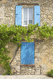 Blue shutter on House. Provence. Stock Photos