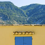 Blue shutter, with mountain view. Provence. Stock Photos