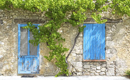 Blue shutter, with old door in Provence. Stock Image
