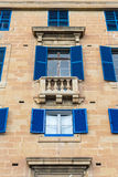 Blue shutter windows and balcony Royalty Free Stock Images