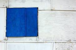 Blue Shutter on a Wooden Exterior Wall Stock Photos