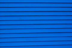 Blue shuttered roll up metal door Stock Image