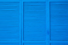 Blue shuttered roll up metal door Royalty Free Stock Image