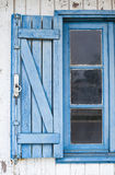 Blue shuttered window Stock Photo