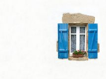 Blue shuttered window on white Stock Photos