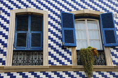 Blue shuttered window Stock Images