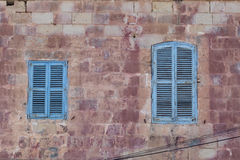 Blue shuttered windows on traditional Maltese House Royalty Free Stock Photos