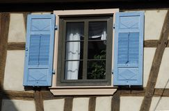 Blue Shutters. The half-timbered framework and the blue shutters are typical for the Alsace area of France Royalty Free Stock Photo