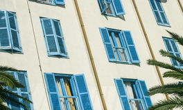 Blue shutters on a building, Tivat in Montenegro Stock Images