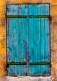 Blue Shutters. Closed Blue Shutters with green hinges Royalty Free Stock Image