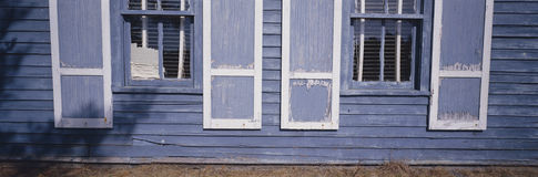 Blue shutters and exterior wall of a WI house Stock Photos