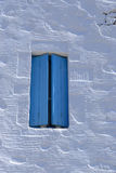 Blue shutters on Greek home Stock Photos