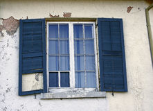 Blue Shutters Glass Window Stucco House Stock Photo