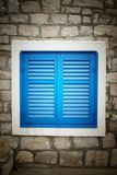 Blue shutters in old stone house Stock Photos