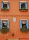 Blue shutters on orange wall Royalty Free Stock Photography