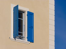 Blue shutters and sky Stock Photography