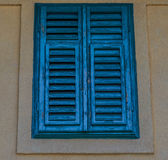 Blue Shutters. Wooden and blue closed shutters royalty free stock images