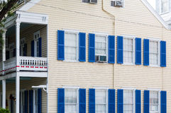 Blue Shutters on Yellow Siding Home Royalty Free Stock Images