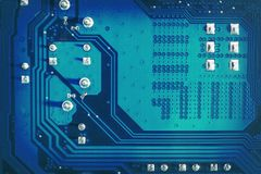 Blue side of motherboard circuit with soldered contacts and texture. High-tech abstract background with digital and new-age. Computer technology concept royalty free stock photography