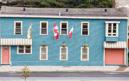 Blue Siding Building with Canadian Flag Stock Photo