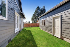 Blue siding house with matching detached garage Royalty Free Stock Photos