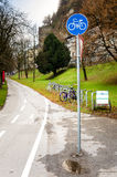 Blue Sign along a Bicycle Path Stock Photography