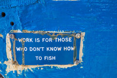 Work and fish Royalty Free Stock Photography