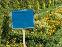 Blue Sign in the garden Stock Photos