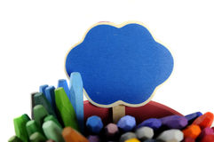 Blue sign on metal bucket full of crayon. Royalty Free Stock Photo