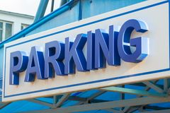 Blue sign over the parking Parking volumetric letters Royalty Free Stock Photo