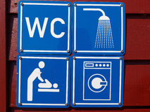 Blue sign of public toilets WC shower washing machines baby Royalty Free Stock Photo