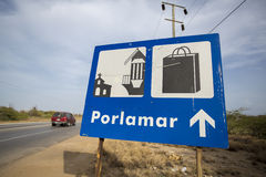 Blue sign road to shpping and church in Porlomar, Venezuela Stock Photography