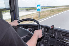Blue sign is seen from the cab of the vehicle Royalty Free Stock Image