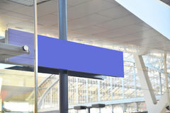 Blue Sign in a station Royalty Free Stock Image
