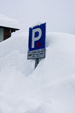 Blue sign to car park. Covered with snow Stock Photography