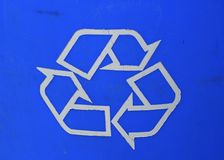 A Blue Recycling Sign asks people to recycle their trash. A blue sign in the USA asks for people to recycle their paper, glass, aluminum and other trash Royalty Free Stock Images