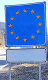 Blue sign with yellow stars in the border area of a European bor Stock Images