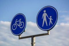 Blue signpost for people and bikes Stock Photography