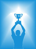 Blue Silhouette of Man Holding Trophy Royalty Free Stock Photography