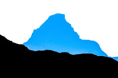 Blue silhouette of mountain peak with summit cross. Hochvogel, Bavaria Royalty Free Stock Photos