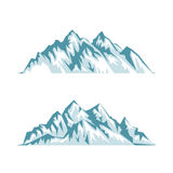 Blue silhouette of mountains with shadows, lights and snow Royalty Free Stock Images