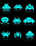 Blue silhouettes of Space Invaders. On a black background Stock Photography