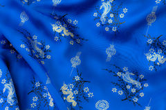 Blue Silk. Chinese wrinkle blue silk with dragon, phoenix, lantern and flowers pattern royalty free stock photo