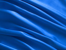 Blue silk. Draperies from real blue silk royalty free stock photography