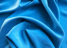 Blue silk background. With wave Stock Images