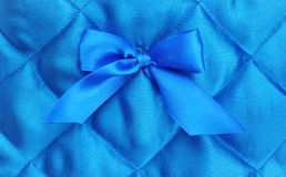 Blue silk background. With a bow Royalty Free Stock Photo